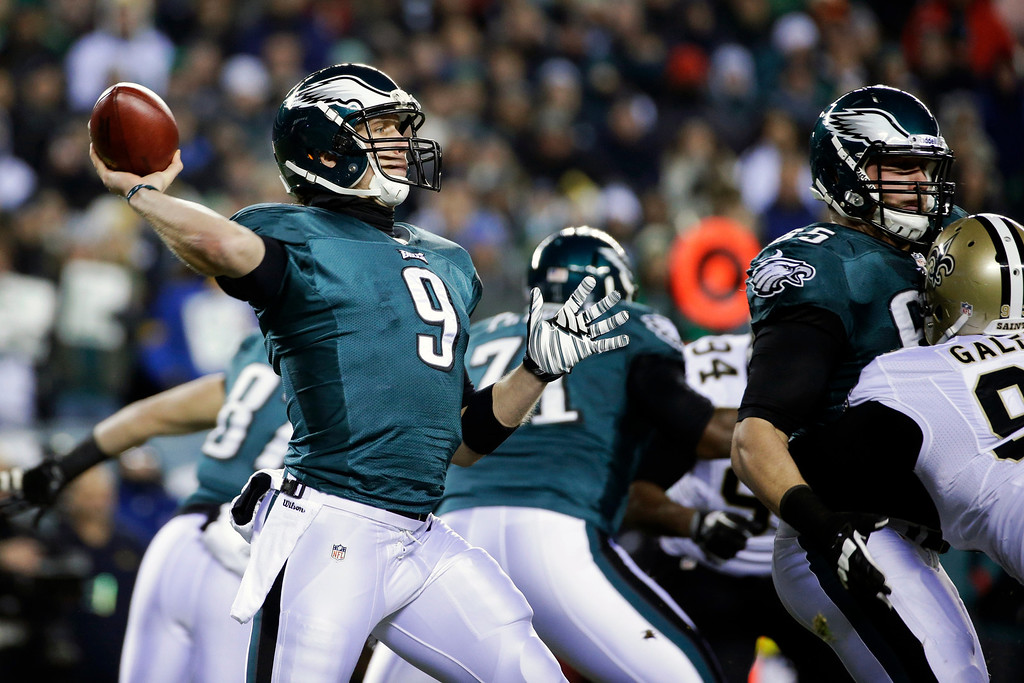 Description of . Philadelphia Eagles' Nick Foles drops back during the first half of an NFL wild-card playoff football game against the New Orleans Saints, Saturday, Jan. 4, 2014, in Philadelphia. (AP Photo/Matt Rourke)