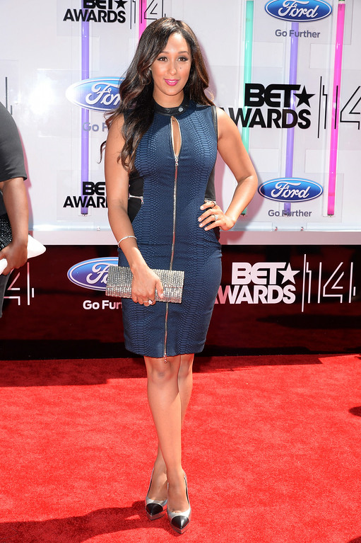 Description of . Actress Tamera Mowry-Housley attends the BET AWARDS '14 at Nokia Theatre L.A. LIVE on June 29, 2014 in Los Angeles, California.  (Photo by Earl Gibson III/Getty Images for BET)