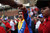 Venezuela's Vice President Nicolas Maduro, center, bumps fists with a supporter as he walks alongside the coffin of Venezuela's late President Hugo Chavez as it is taken from the hospital where Chavez died on Tuesday to a military academy in Caracas, Venezuela, Wednesday, March 6, 2013. Maduro will continue to run Venezuela as interim president and be the governing socialists' candidate in an election to be called within 30 days. (AP Photo/Rodrigo Abd)