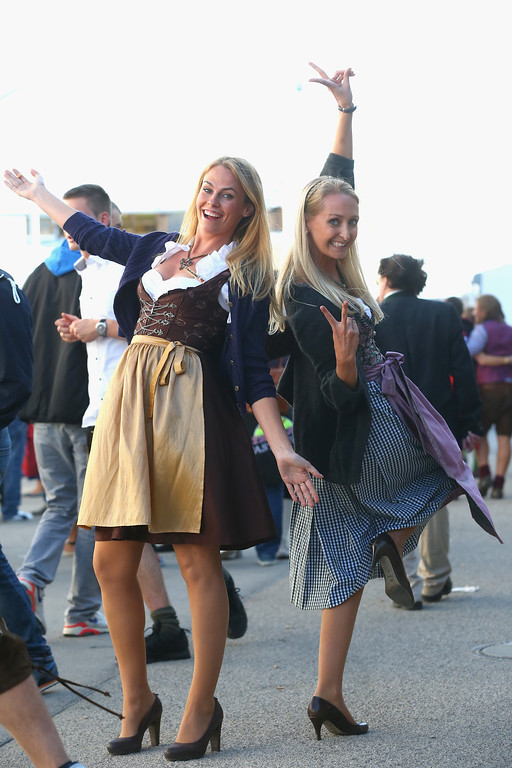 Description of . Revelers dressed in traditional Bavarian clothing `Dirndl` during day 1 of the Oktoberfest 2013 beer festival at Theresienwiese on September 21, 2013 in Munich, Germany. The Munich Oktoberfest, which this year will run from September 21 through October 6, is the world's largest beer fest and draws millions of visitors.  (Photo by Alexander Hassenstein/Getty Images)
