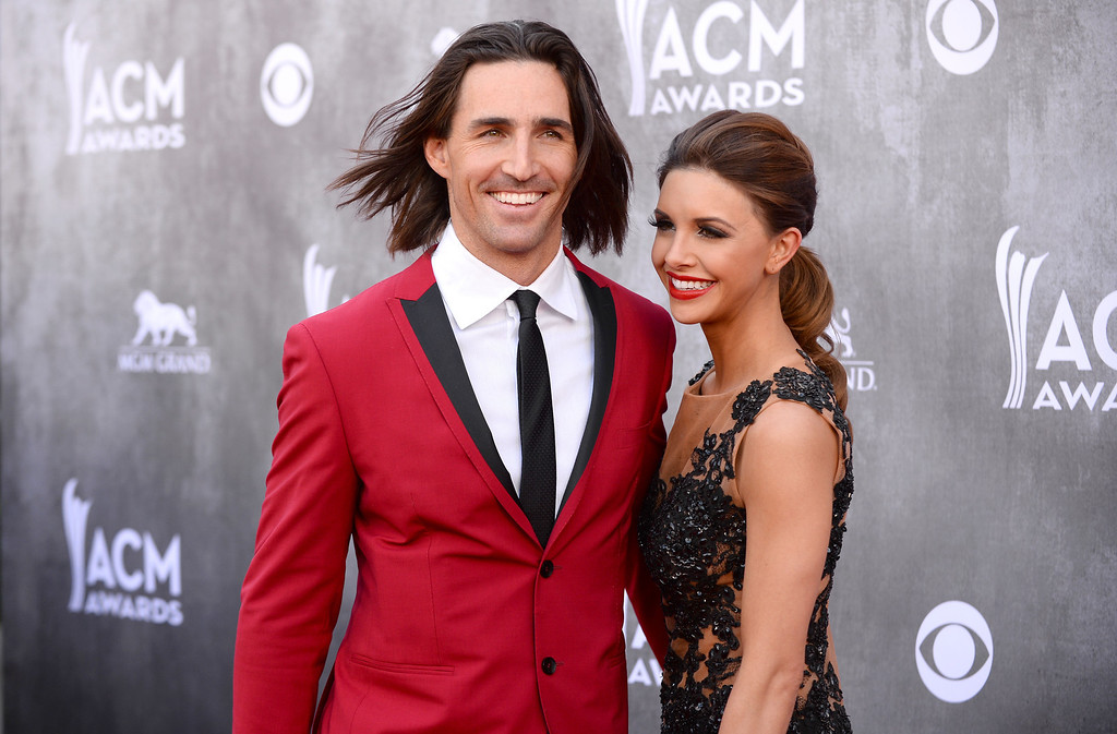 Description of . Jake Owen, left, and Lacey Owen arrive at the 49th annual Academy of Country Music Awards at the MGM Grand Garden Arena on Sunday, April 6, 2014, in Las Vegas. (Photo by Al Powers/Powers Imagery/Invision/AP)