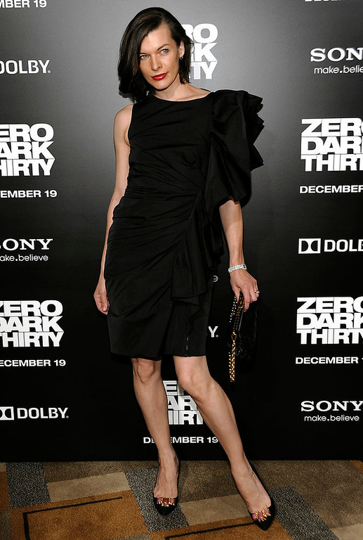 Description of . Actress Milla Jovovich arrives at the premiere of the feature film
