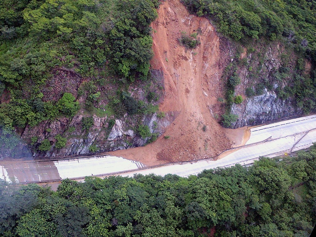 Description of . This handout photo taken and released on September 18, 2013 by Mexico's Interior Ministry press office shows an aerial view of a landslide along a highway going to Acapulco, in the Mexican state of Guerrero, as heavy rains hit the country. AFP PHOTO/ Interior MINISTRY -/AFP/Getty Images