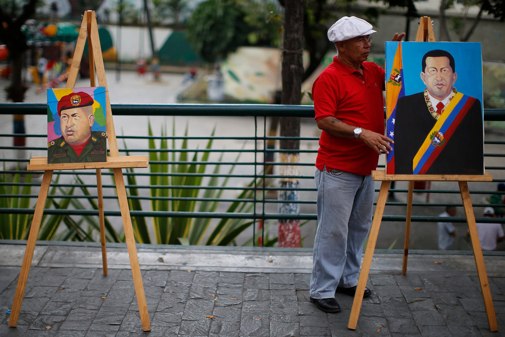 Description of . Painter Felix Rodriguez prepare paintings depicting Venezuelan President Hugo Chavez for sale in Caracas March 5, 2013. Chavez's adoring supporters prayed and wept on Tuesday over a serious setback in his battle against a cancer that threatens to end his 14-year rule of the South American OPEC member. In one of the gloomiest announcements to date on Chavez's health, the government said on Monday night that his breathing problems had worsened and he was suffering from a