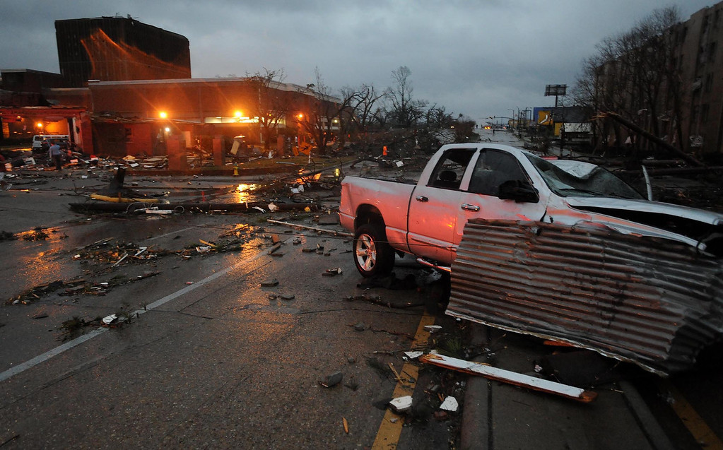 Description of . A heavily damaged vehicle sits near the front of the University of Southern Mississippi on Hardy Street in Hattiesburg Miss., Feb 10, 2013 after a tornado passed through the city Sunday afternoon. (AP Photo/Hattiesburg American, Ryan Moore)
