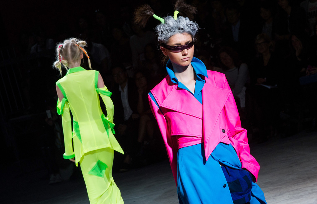 Description of . A model wears a creation for designer Yohji Yamamoto ready-to-wear Spring/Summer 2014 fashion collection, presented in Paris, Friday, Sept.27, 2013. (AP Photo/Zacharie Scheurer)