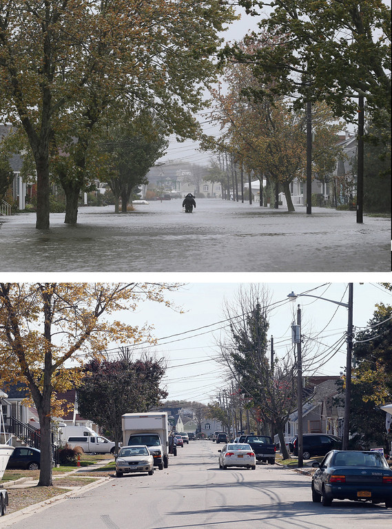 Description of . LINDENHURST, NY - OCTOBER 29: (top) A lone figure makes his way down South 9th Street as high tide, rain and winds flood local streets on October 29, 2012 in Lindenhurst, New York. The storm, which threatens 50 million people in the eastern third of the U.S., is expected to bring days of rain, high winds and possibly heavy snow. LINDENHURST, NY - OCTOBER 22: (bottom) A scenic view of South 9th Street as photographed almost one year following Superstorm Sandy on October 22, 2013 in Lindenhurst, New York. Hurricane Sandy made landfall on October 29, 2012 near Brigantine, New Jersey and affected 24 states from Florida to Maine and cost the country an estimated $65 billion. (Photos by Bruce Bennett/Getty Images)