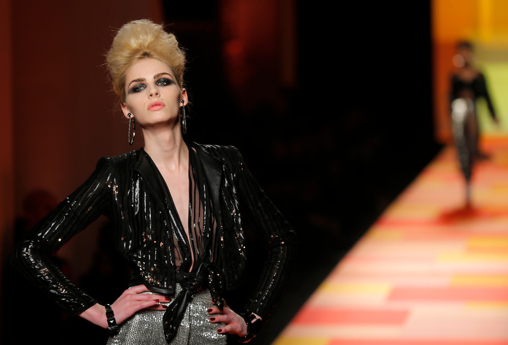 Description of . A model wears a creation for French fashion fashion designer Jean-Paul Gaultier's Spring-Summer 2013 Haute Couture fashion collection, presented in Paris, Wednesday, Jan.23, 2013. (AP Photo/Jacques Brinon)
