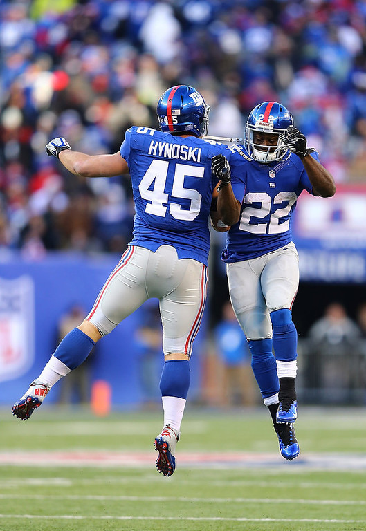 Description of . Henry Hynoski #45 of the New York Giants celebrates his touchdown with  David Wilson #22 of the New York Giants against the Philadelphia Eagles during their game at MetLife Stadium on December 30, 2012 in East Rutherford, New Jersey.  (Photo by Al Bello/Getty Images)