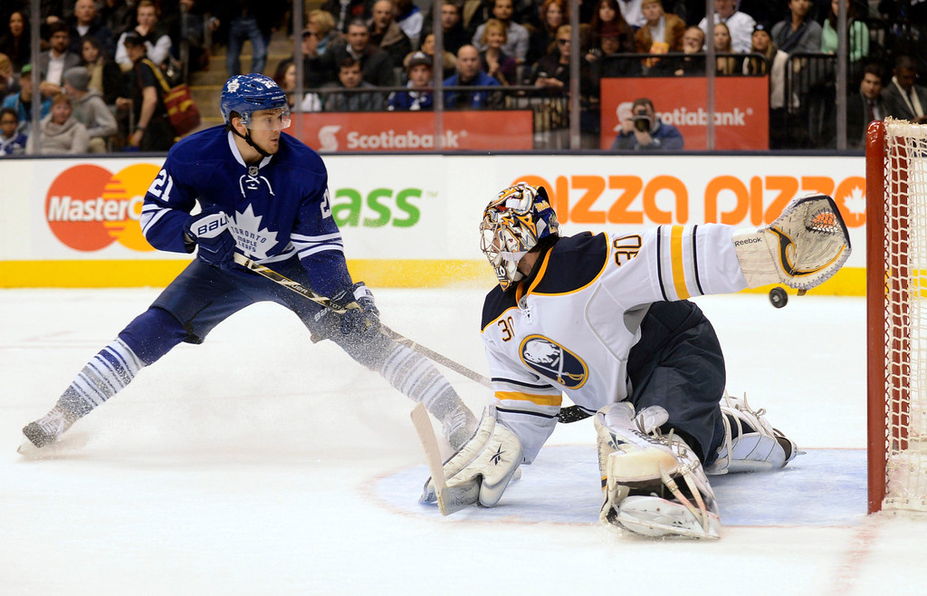 . Toronto Maple Leafs James van Riemsdyk (L) scores on Buffalo Sabres goalie Ryan Miller (R) during the second period of their NHL hockey game in Toronto February 21, 2013. REUTERS/Aaron Harris