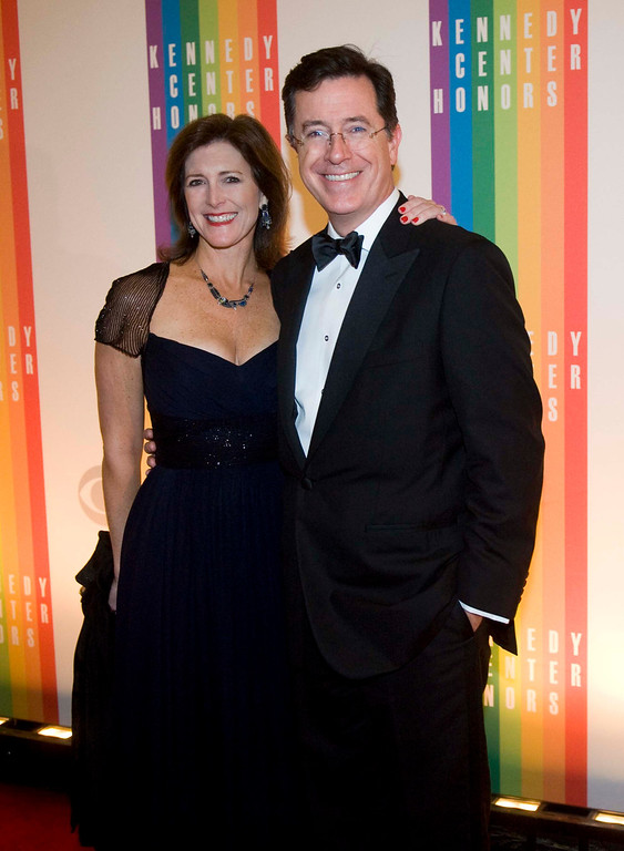 Description of . Comedian Stephen Colbert and wife, Evelyn Colbert, arrive at the Kennedy Center for the Performing Arts for the 2012 Kennedy Center Honors Performance and Gala Sunday, Dec. 2, 2012 at the State Department in Washington. (AP Photo/Kevin Wolf)
