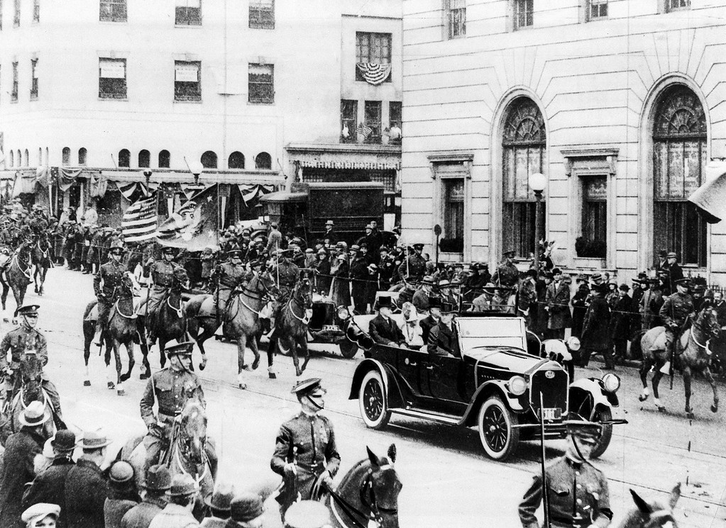 Description of . President Calvin Coolidge rides in an open car at the head of the inaugural parade with his wife Grace and Chief Justice Wiliam H. Taft in Washington, D.C., on March 4, 1925. Coolidge was sworn in as the 30th president of the United States. (AP Photo)