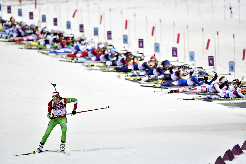 Description of . Darya Domracheva of Belarus wins gold medal during the Biathlon Women's 12.5km Mass Start at the Laura Cross-country Ski & Biathlon Center on February 17, 2014 in Sochi, Russia. (Photo by Vianney Thibaut/Agence Zoom/Getty Images)