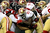 Running back Frank Gore #21 of the San Francisco 49ers runs the ball in the first quarter as he is hit by defensive tackle Corey Peters #91 of the Atlanta Falcons in the NFC Championship game at the Georgia Dome on January 20, 2013 in Atlanta, Georgia.  (Photo by Streeter Lecka/Getty Images)
