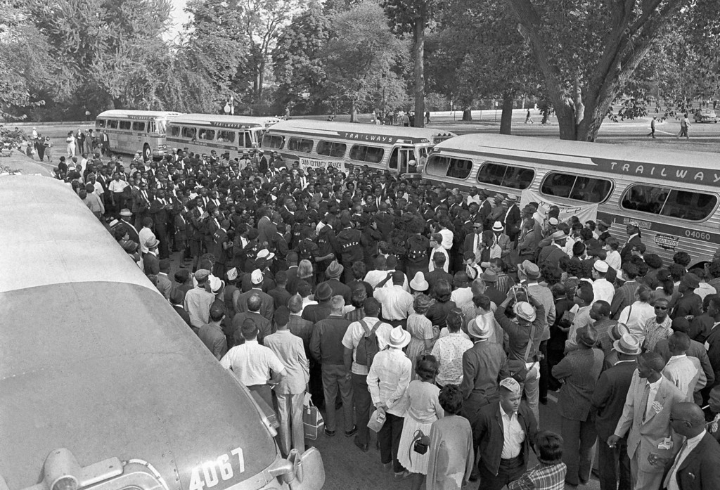 Description of . NAACP group from Wilmington, N.C., sing in the street near the Washington monument grounds, Aug. 28, 1963 after their arrival to participate in the March on Washington. (AP Photo)