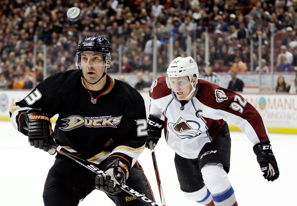 Description of . Anaheim Ducks defenseman Francois Beauchemin, left, battles Colorado Avalanche left wing Gabriel Landeskog for the puck during the second period of an NHL hockey game in Anaheim, Calif., Sunday, Feb. 24, 2013. (AP Photo/Chris Carlson)