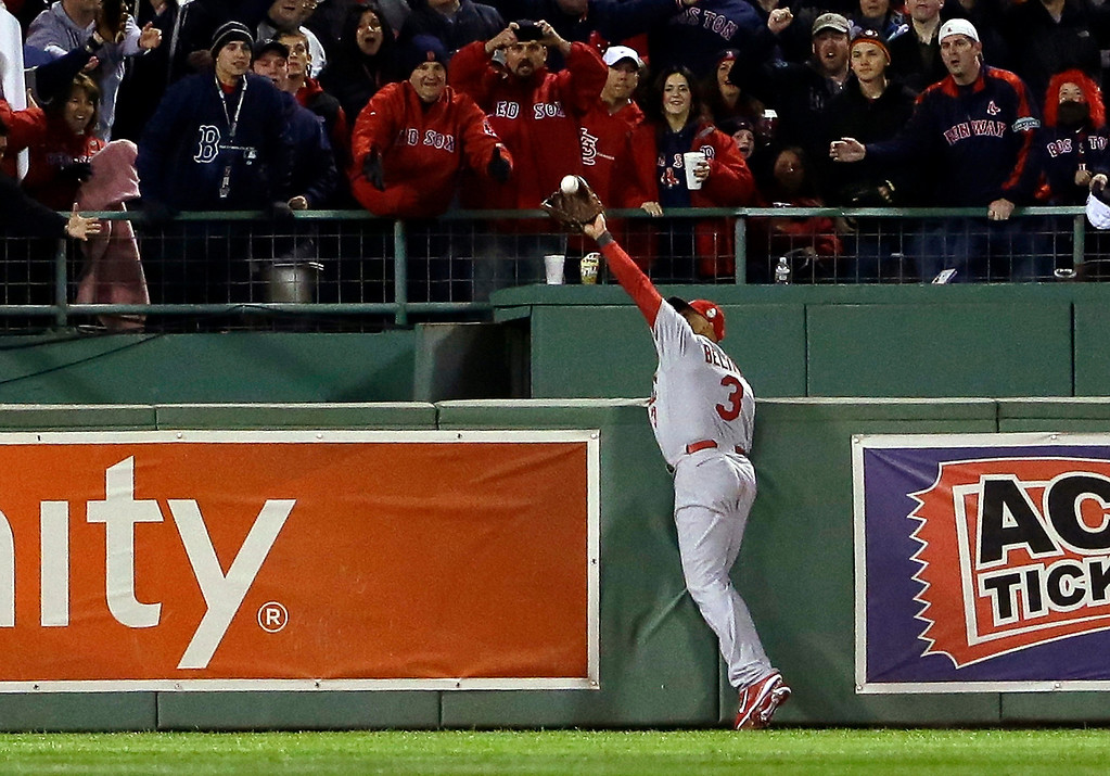 Description of . St. Louis Cardinals' Carlos Beltran makes a catch by Boston Red Sox's David Ortiz during the second inning of Game 1 of baseball's World Series Wednesday, Oct. 23, 2013, in Boston. (AP Photo/Matt Slocum)