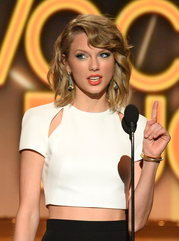 Description of . Singer/songwriter Taylor Swift speaks onstage during the 49th Annual Academy Of Country Music Awards at the MGM Grand Garden Arena on April 6, 2014 in Las Vegas, Nevada.  (Photo by Ethan Miller/Getty Images)