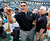 Carolina Panthers head coach Ron Rivera, left, shouts at players as Atlanta Falcons head coach Mike Smith, right, watches after an NFL football game in Charlotte, N.C., Sunday, Dec. 9, 2012. The Panthers won 30-20. (AP Photo/Bob Leverone)