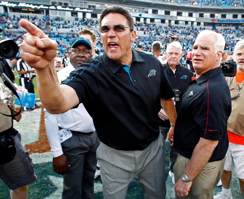 . Carolina Panthers head coach Ron Rivera, left, shouts at players as Atlanta Falcons head coach Mike Smith, right, watches after an NFL football game in Charlotte, N.C., Sunday, Dec. 9, 2012. The Panthers won 30-20. (AP Photo/Bob Leverone)