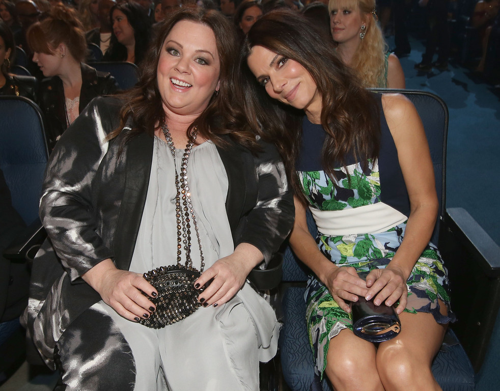 Description of . LOS ANGELES, CA - JANUARY 08:  Actors Melissa McCarthy (L) and Sandra Bullock attend The 40th Annual People's Choice Awards at Nokia Theatre L.A. Live on January 8, 2014 in Los Angeles, California.  (Photo by Christopher Polk/Getty Images for The People's Choice Awards)