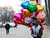 A youth selling balloons counts money on Valentine's Day at a shopping district in Beijing February 14, 2013. REUTERS/Kim Kyung-Hoon