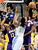 Los Angeles Lakers' Dwight Howard (L) and Earl Clark (R) block Denver Nuggets' Kenneth Faried during their NBA basketball game in Denver, Colorado February 25, 2013.   REUTERS/Mark Leffingwell