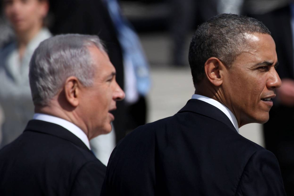 Description of . U.S. President Barack Obama (R) is greeted by Israeli Prime Minister Benjamin Netanyahu during an official welcoming ceremony on his arrival at Ben Gurion International Airport on March, 20, 2013 near Tel Aviv, Israel. (Photo by Marc Israel Sellem-Pool/Getty Images)