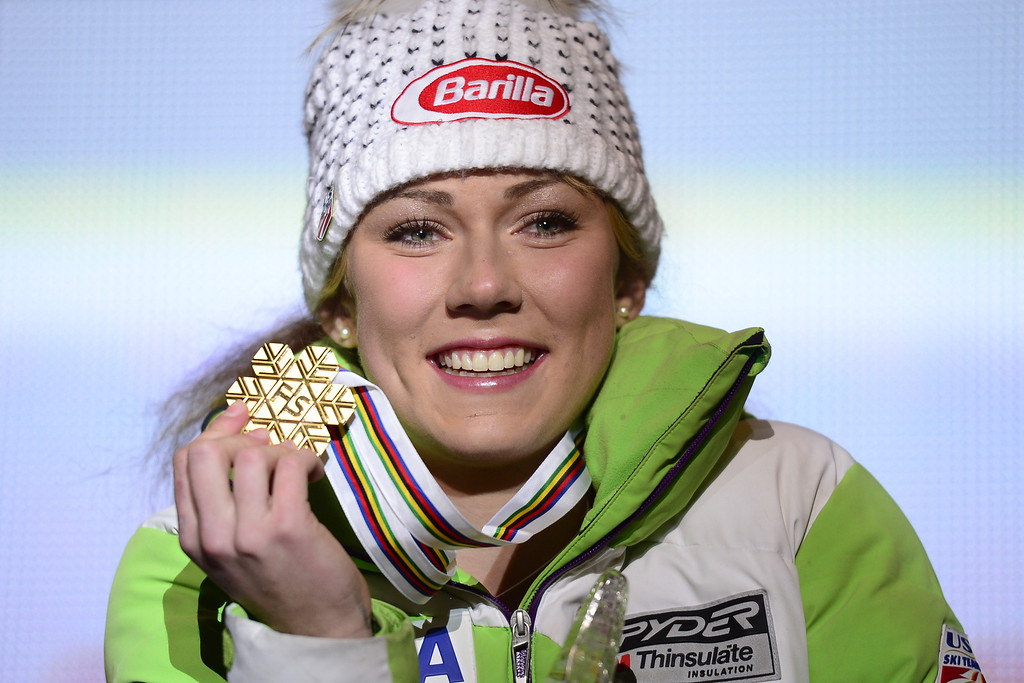 Description of . Mikaela Shiffrin of the US poses with her gold medal during the medal awards ceremony after the women's slalom at the 2013 Ski World Championships in Schladming, Austria on February 16, 2013.OLIVIER MORIN/AFP/Getty Images
