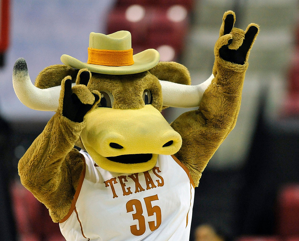 Description of . The Texas mascot dances during a timeout in the second half of game against Penn in the first round of the NCAA women's college basketball tournament on Sunday, March 23, 2014, in College Park, Md. Texas won 79-61. (AP Photo/Gail Burton)