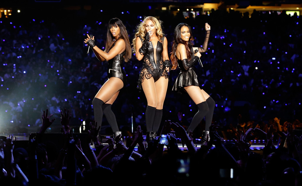 Description of . Singers Kelly Rowland, Beyonce and Michelle Williams perform during the Pepsi Super Bowl XLVII Halftime Show at the Mercedes-Benz Superdome on February 3, 2013 in New Orleans, Louisiana.  (Photo by Ezra Shaw/Getty Images)