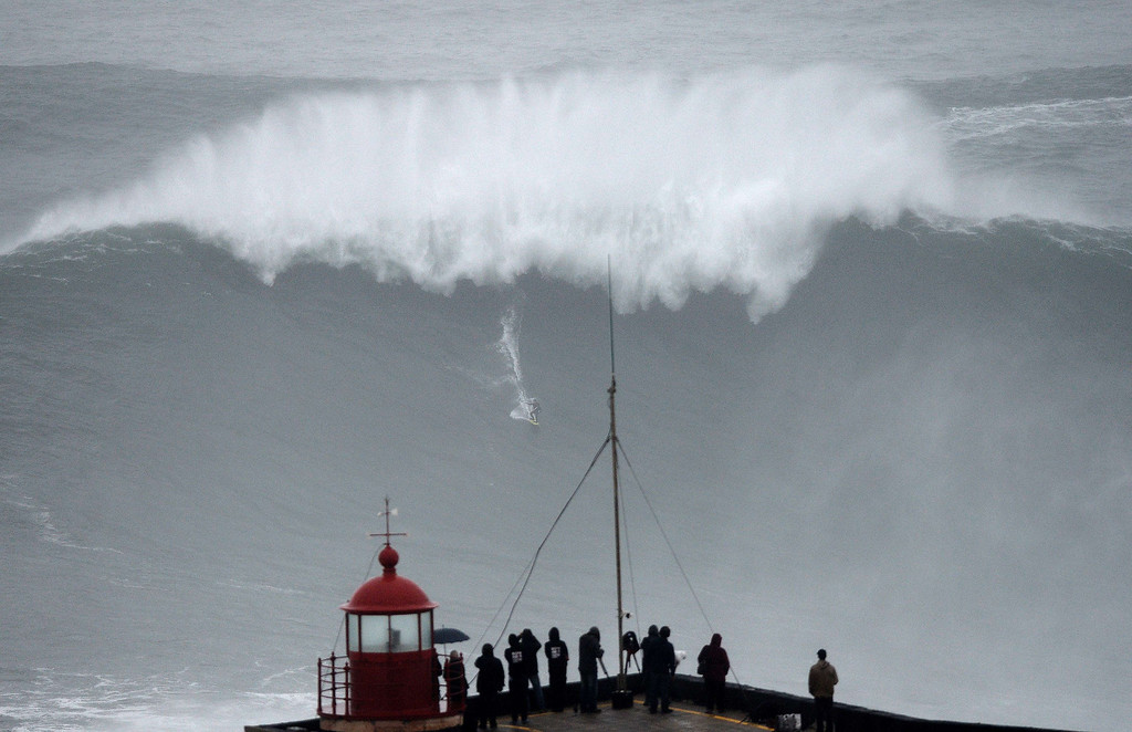 Description of . Brazilian big wave surfer Carlos Burle rides a wave in Nazare, central Portugal, on October 28, 2013.   FRANCISCO LEONG/AFP/Getty Images