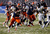 Prince-Tyson Gulley #23 of the Syracuse Orange runs in for touchdown against the West Virginia Mountaineers during the New Era Pinstripe Bowl at Yankee Stadium on December 29, 2012 in the Bronx borough of New York City.  (Photo by Jeff Zelevansky/Getty Images)