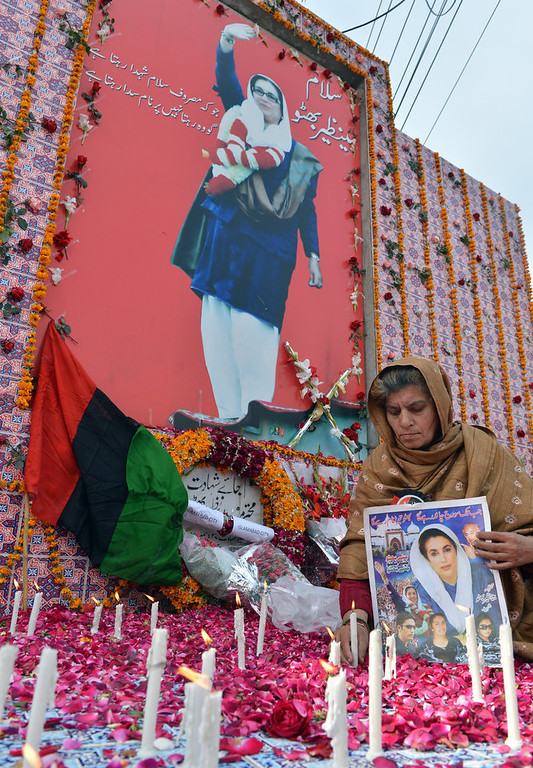 Description of . A supporter of the ruling Pakistan Peoples Party (PPP) lights candles at the site where former premier Benazir Bhutto was assassinated, on her fifth death anniversary in Rawalpindi on December 27, 2012. The son of Pakistan's slain former prime minister Benazir Bhutto launched his political career Thursday on the anniversary of his mother's death with an attack on the country's judiciary. More than 200,000 people gathered at the Bhutto family mausoleum in Garhi Dera Bakhsh in the southern province of Sindh to pay their respects to Benazir and to hear Bilawal Bhutto Zardari make his first major public speech. AFP PHOTO/Aamir  QURESHI/AFP/Getty Images
