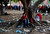 Supporters of Venezuela's late President Hugo Chavez sit at a tree as they wait for a chance to view his body lying in state, at the military academy in Caracas March 8, 2013.         REUTERS/Tomas Bravo