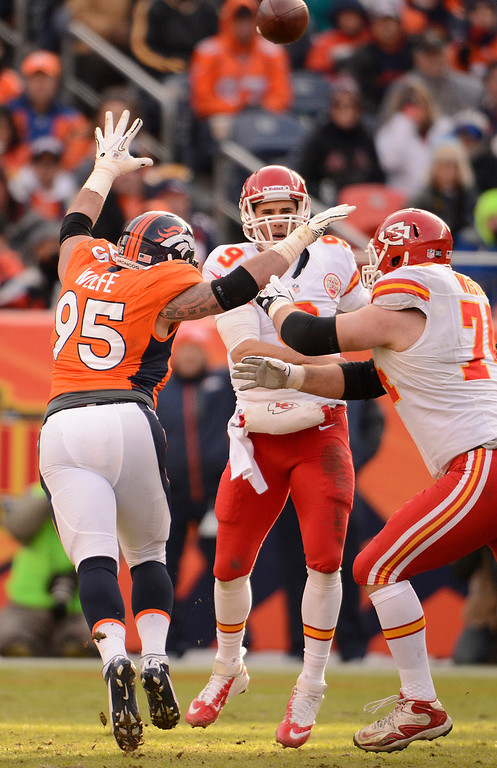 Description of . Denver Broncos defensive end Derek Wolfe (95) puts pressure on Kansas City Chiefs quarterback Brady Quinn (9) as the Denver Broncos took on the Kansas City Chiefs at Sports Authority Field at Mile High in Denver, Colorado on December 30, 2012. John Leyba, The Denver Post