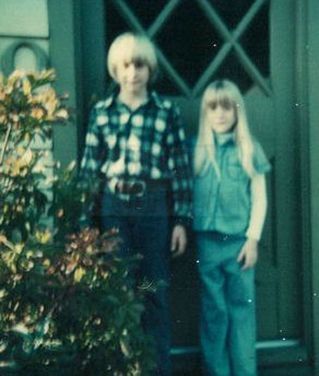 Description of . This undated photo provided by Kim Cobain, Kurt Cobain's sister, shows a young Kurt Cobain, left, and Kim in their childhood home in Aberdeen, Wash.  (AP Photo/Courtesy Kim Cobain)