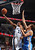 Memphis Grizzlies forward Rudy Gay (22) shoots, defended by Denver Nuggets center Timofey Mozgov of Russia (25), during the first half of their NBA basketball game in Memphis, Tennessee December 29, 2012.  REUTERS/Nikki Boertman (UNITED STATES - Tags: SPORT BASKETBALL)