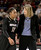 University of Colorado head coach Linda Lappe talks with Brittany Wilson on the sideline during a games against the University of Denver on Tuesday, Dec. 11, at the Magnus Arena on the DU campus in Denver.   (Jeremy Papasso/Daily Camera)