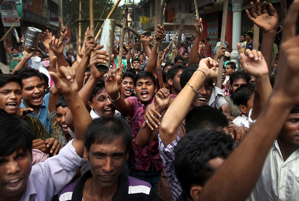 Description of . Protestors march down the street, demanding the death penalty for those responsible for the April 24 collapse of a garment factory building that killed hundreds in Savar, near, Dhaka, Bangladesh, Tuesday, April 30, 2013. (AP Photo/Wong Maye-E)