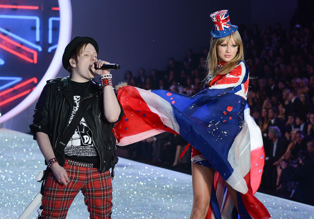 Description of . Singers Patrick Stump of Fall Out Boy and Taylor Swift perform during the 2013 Victoria's Secret Fashion Show at the 69th Regiment Armory on Wednesday, Nov. 13, 2013 in New York. (Photo by Evan Agostini/Invision/AP)