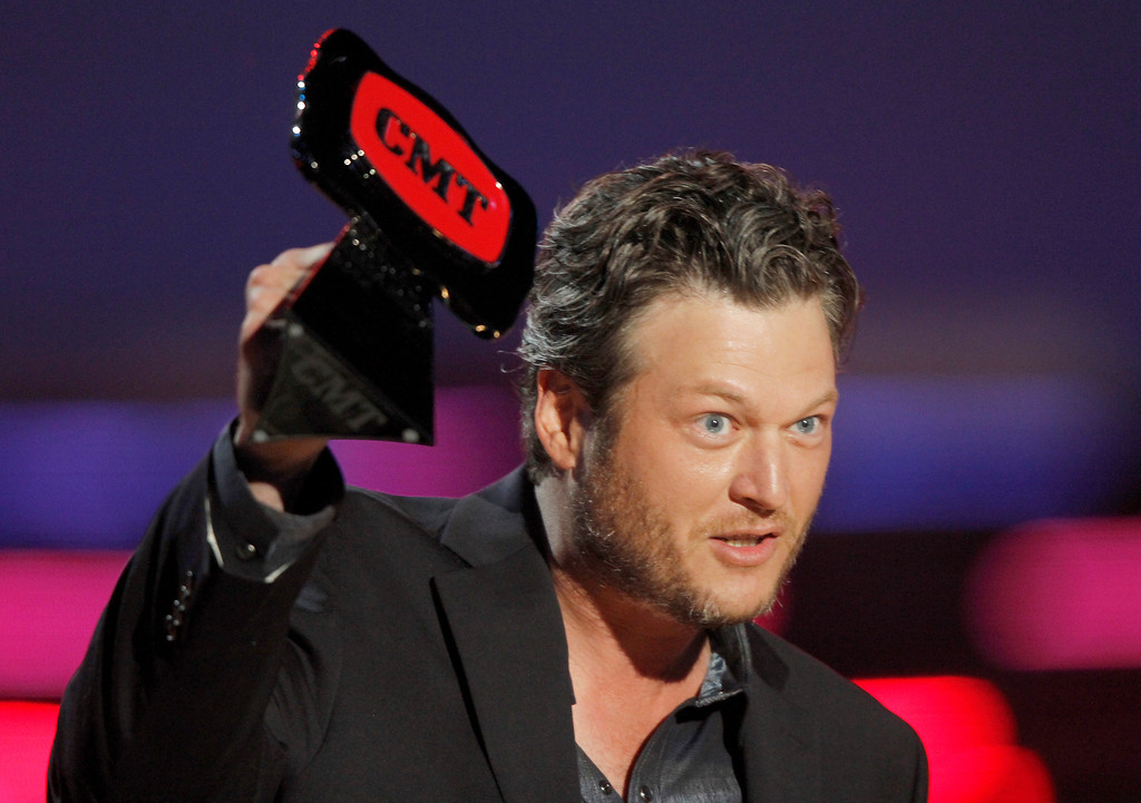 Description of . Blake Shelton accepts the award for male video of the year for ìDoiní What She Likesî at the CMT Music Awards at Bridgestone Arena on Wednesday, June 4, 2014, in Nashville, Tenn. (Photo by Wade Payne/Invision/AP)