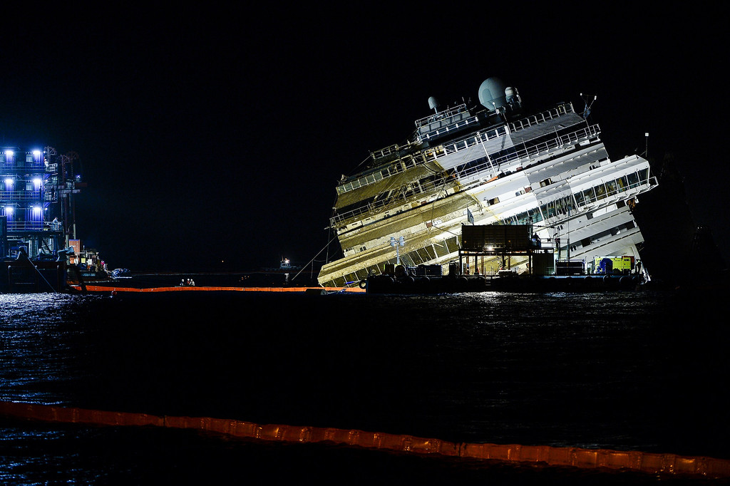 Description of . The wreck of Italy's Costa Concordia cruise ship is almost upright as alvage workers attempted to raise the cruise ship in the largest and most expensive maritime salvage operation in history, so-called