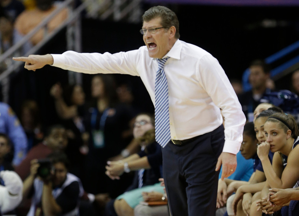 Description of . Connecticut head coach Geno Auriemma directs his team against Notre Dame in the first half of the women\'s NCAA Final Four college basketball tournament semifinal against Notre Dame, Sunday, April 7, 2013, in New Orleans. (AP Photo/Gerald Herbert)