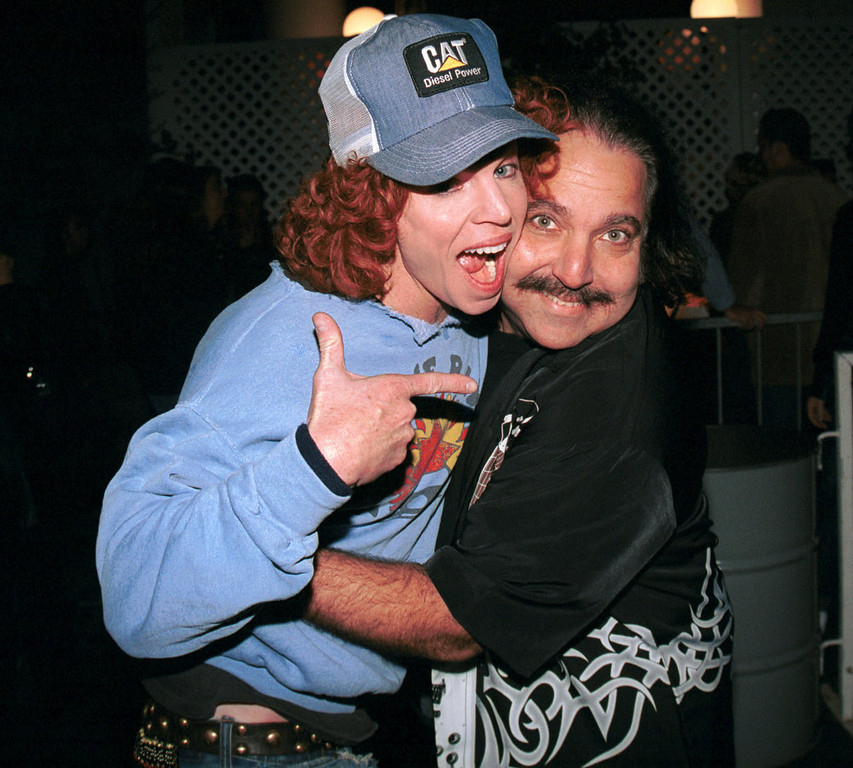 Description of . Actor/comedian Carrot Top poses with porn star, Ron Jeremy, outside Hollywood Bowl during the Aerosmith concert on November 3, 2002 in Hollywood, California.  (Photo by David Klein/Getty Images)