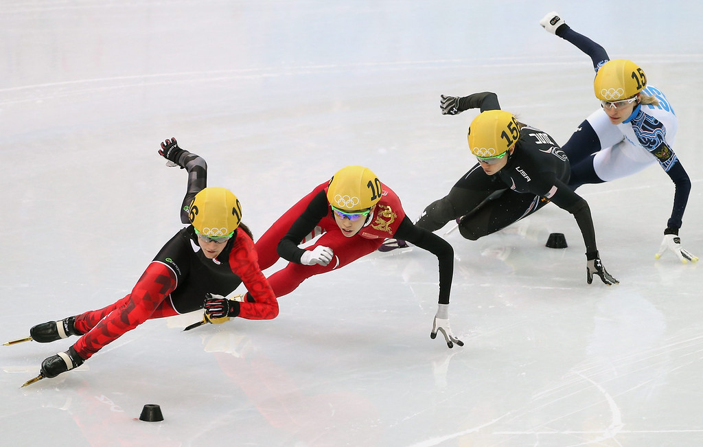 . Jessica Hewitt (L) of Canada leads ;Fan Kexin of China, Jessica Smith of USA and Russia\'s Valeriya Reznikin heat 7 in women\'s 500m of the Short Track competitions in the Iceberg Skating Palace at the Sochi 2014 Olympic Games, in Sochi, Russia, on Feb. 10, 2014. EPA/HOW HWEE YOUNG