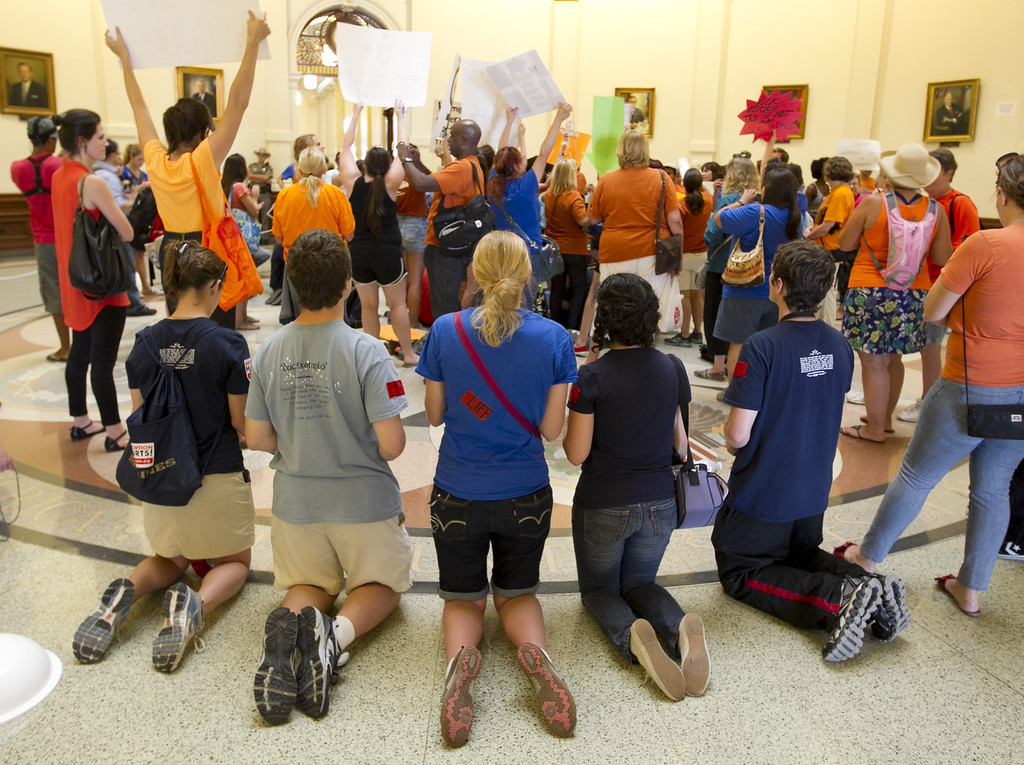 Description of . People on both sides of the abortion debate demonstrate during the debate of the abortion restriction bill,  Friday July 12, 2013  at the Capitol in Austin, Texas  (AP Photo/Austin American-Statesman, Jay Janner)