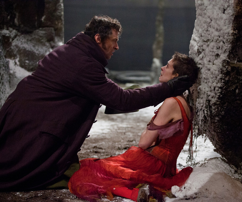 Description of . This film image released by Universal Pictures shows Hugh Jackman as Jean Valjean, left, and Anne Hathaway as Fantine in a scene from