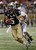 Central Florida quarterback Blake Bortles (5) eludes Ball State safety Jarrett Swaby (34) on a run during the first quarter of the Beef 'O' Brady's Bowl NCAA college football game Friday, Dec. 21, 2012, in St Petersburg, Fla. (AP Photo/Chris O'Meara)