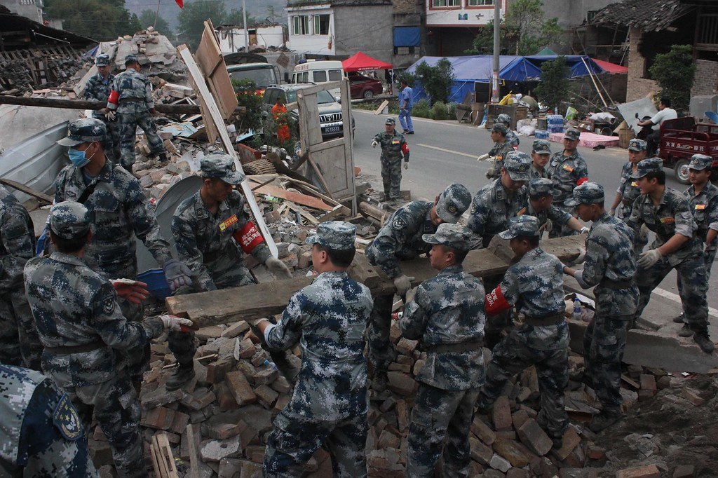 Description of . LUSHAN, CHINA - APRIL 25:  (CHINA OUT) Rescuers clean up the debris at Gucheng village on April 25, 2013 in Lushan County, China. A powerful earthquake struck the Lushan county of China's southwestern Sichuan province on the morning of April 20, leaving at least 196 people dead and more than 12,200 injured.  (Photo by ChinaFotoPress/ChinaFotoPress via Getty Images)